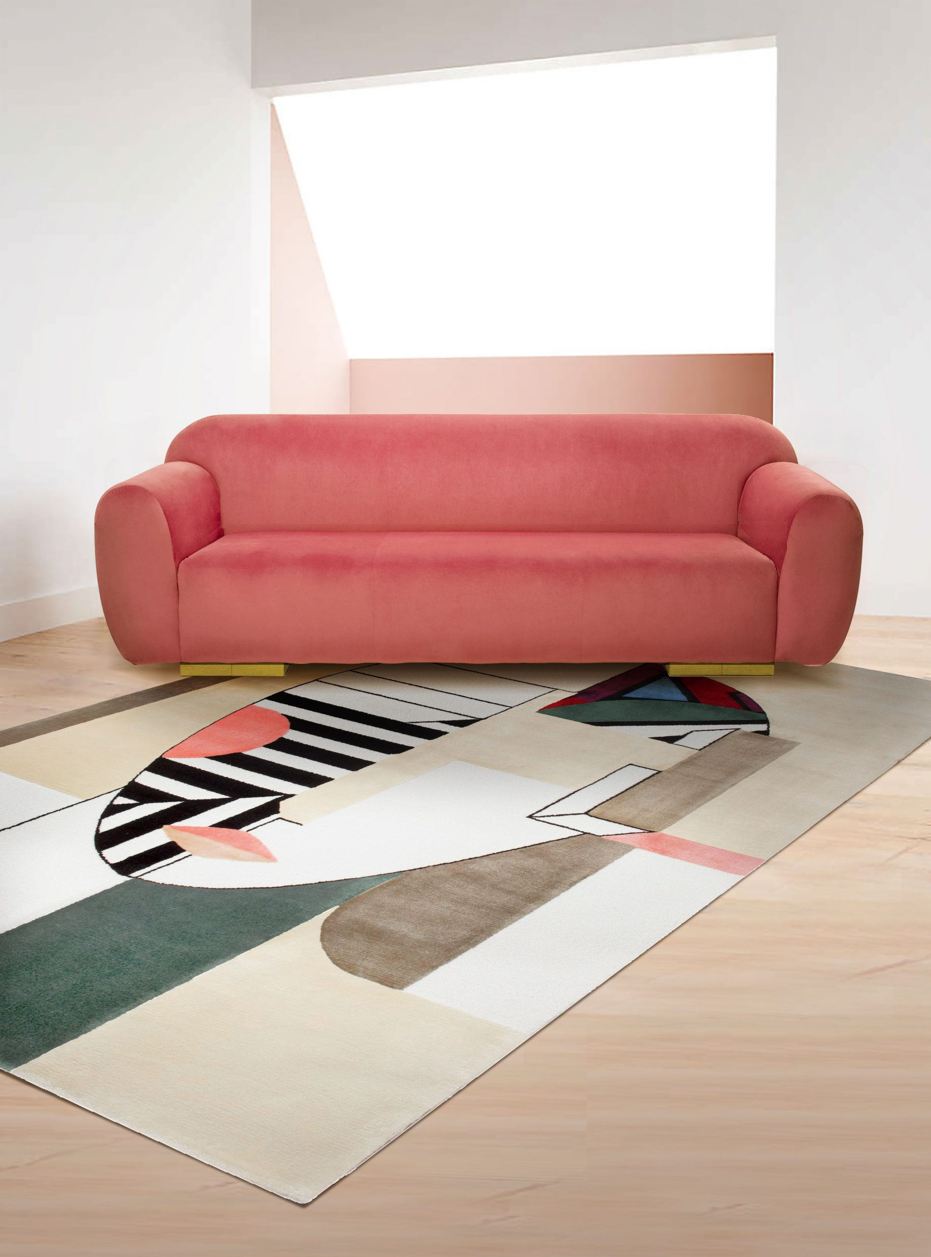 LIVING ROOM WITH OSCAR COLORFUL RUG AND PINK DETAILS